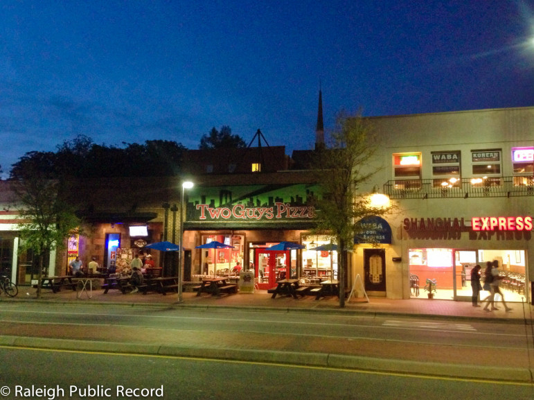 Several properties on Hillsborough Street, including Two Guys Pizza and Amina's Cafe, will be torn down for a new student-housing development