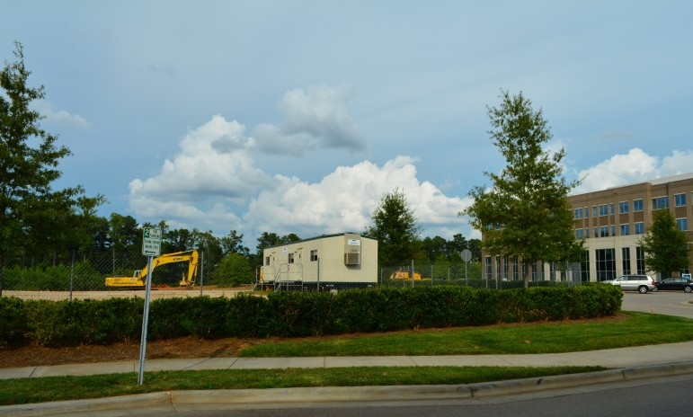 Sitework for a new parking deck and office building is underway at Wade Park