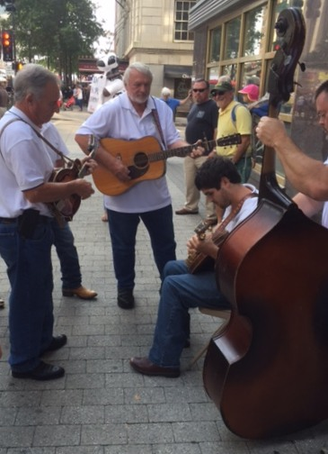 A street band performs at the Wide Open Bluegrass Festival