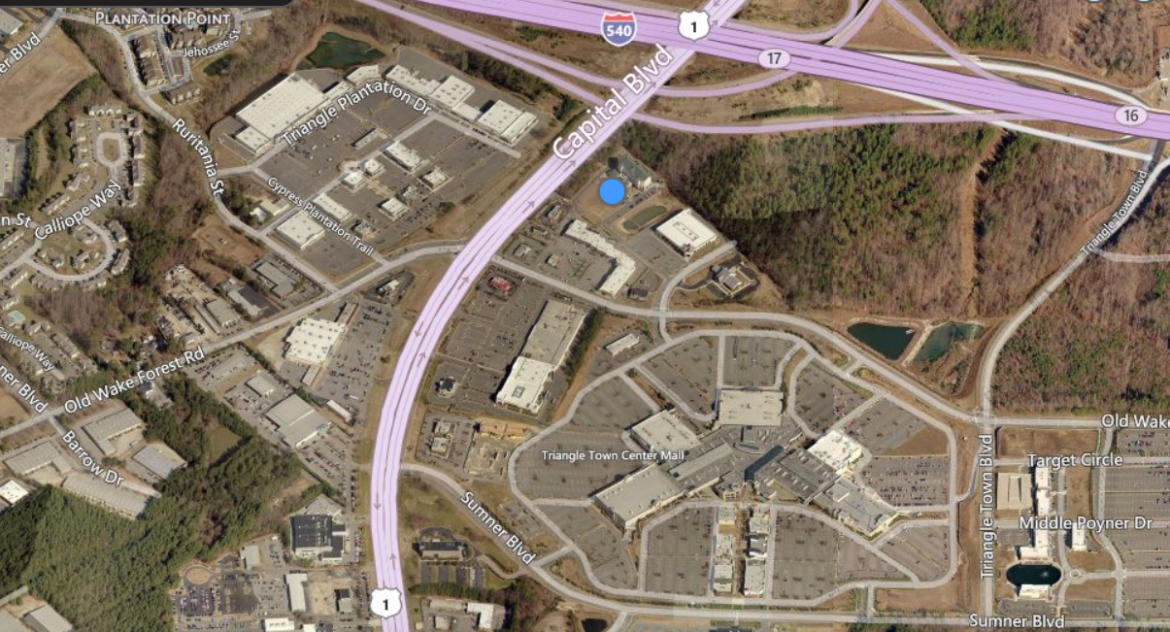 The blue dot indicates the empty lot where the new hotel will be built