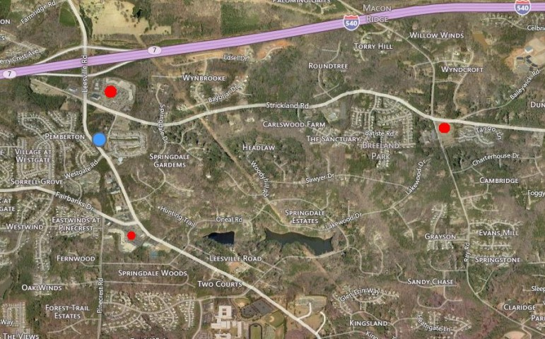 The blue dot indicates where the proposed shopping center in Z-14-15 would go. The red dots indicate existing grocery stores.