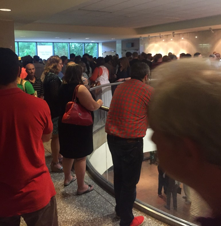 Hundreds of residents spilled out into overflow areas set up throughout city hall