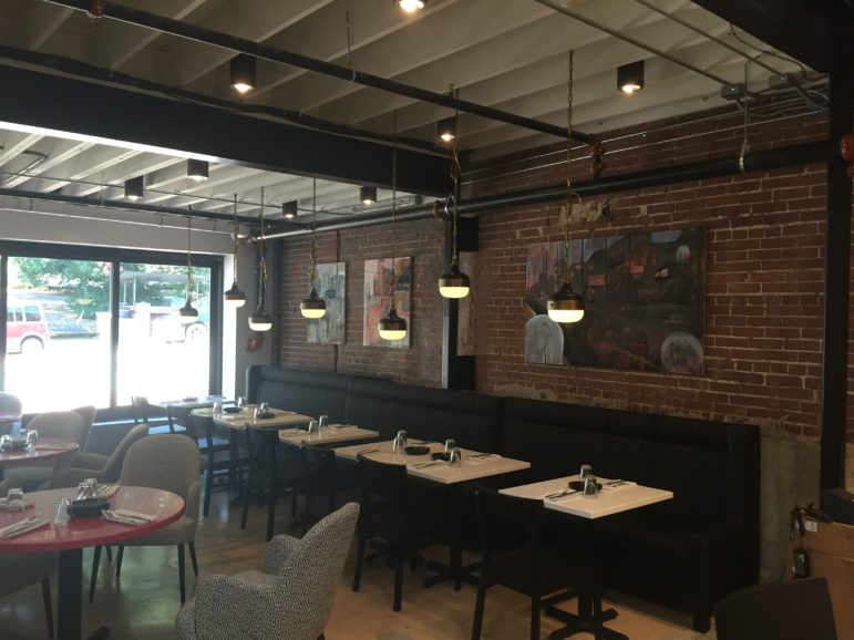 Luke Buchanan's paintings hang in one of the front wings of the restaurant