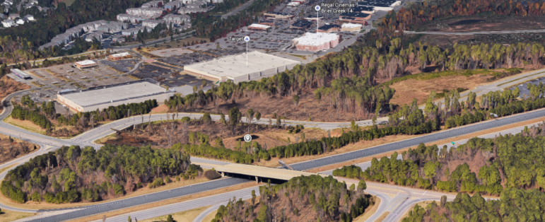 The hotel will be built on this prime piece of land between the highway and the highway off-ramp